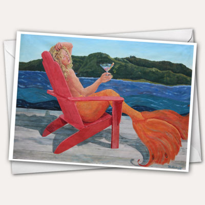 Mermaid's Cocktail Hour Greeting Card with Blond Mermaid drinking fancy cocktail in one Hallowell, Maine's colorful adirondack chairs by the Kennebec River